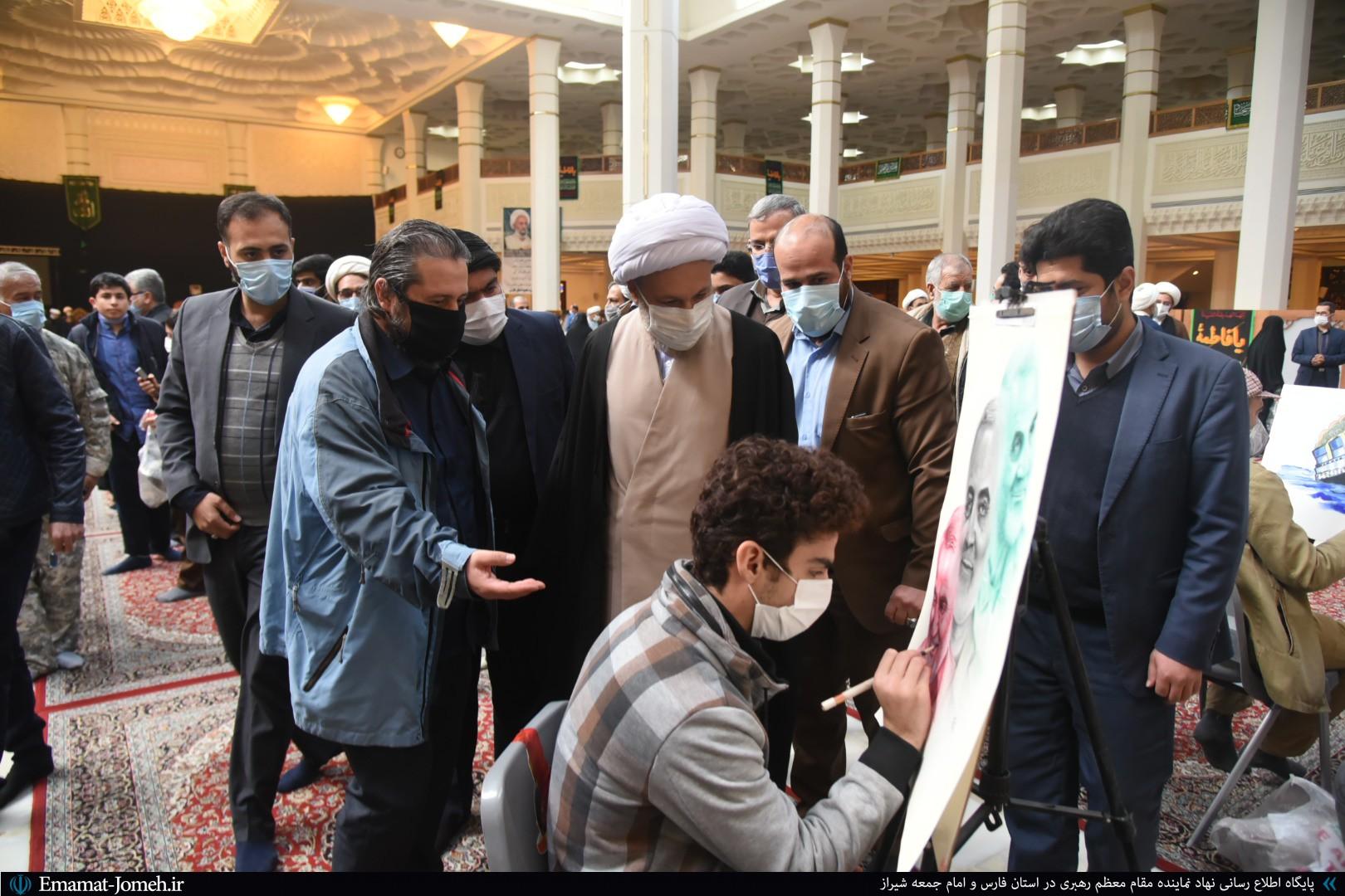بازدید آیت الله دژکام از نمایشگاه هنری مرتبط با شهید سلیمانی و شهید فخری زاده